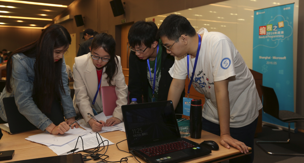 UX designer Xuelun Fu (far left) discussing project idea with team members.