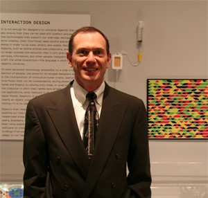 Gavin Jancke at the Museum of Modern Art in front of his multicolored high-capacity barcode.