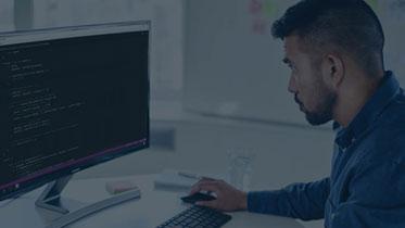 Man coding the bot framework into an app
