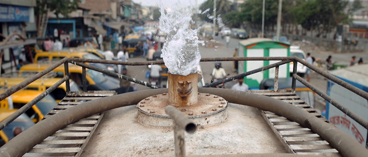photo of water gushing out of a pipe
