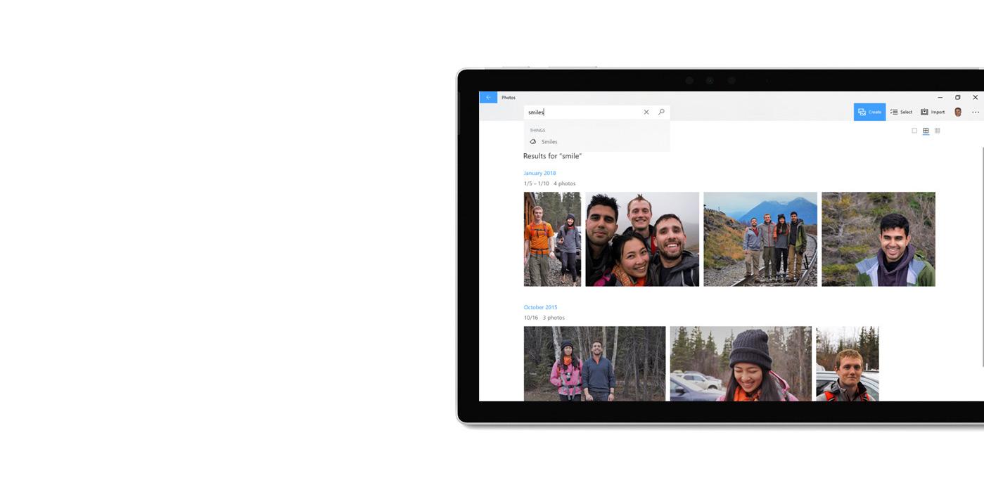 Tableta que muestra la aplicación Fotos, donde se usa la función de búsqueda para buscar imágenes.