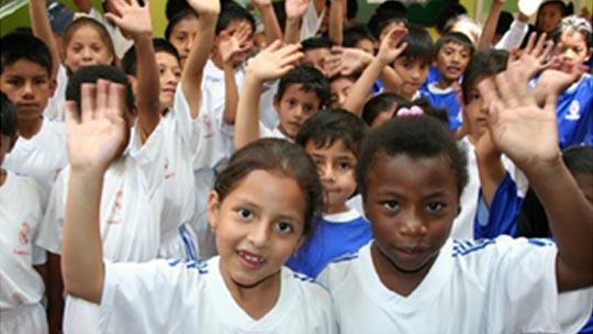 children waving to the camera