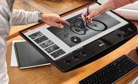 An image of two workers collaborating on a model of a bicycle with ink in PowerPoint.