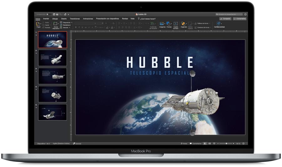 Imagen de un dispositivo MacBook Pro abierto con PowerPoint en modo oscuro en la pantalla.