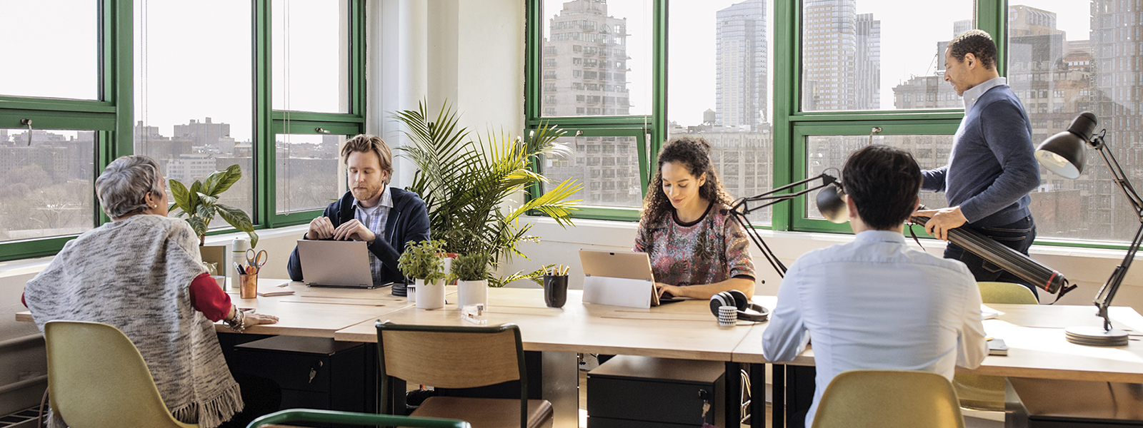 Group of people working in an office.