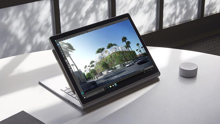 Surface Book 2 katselutilassa yhdessä Surface-kynän ja Surface Dialin kanssa.