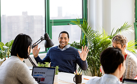 Image of a small business team collaborating in modern workplace.