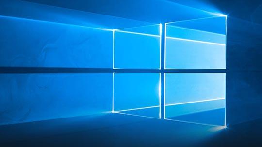 Une fenêtre à quatre vitres avec des rayons de lumière.