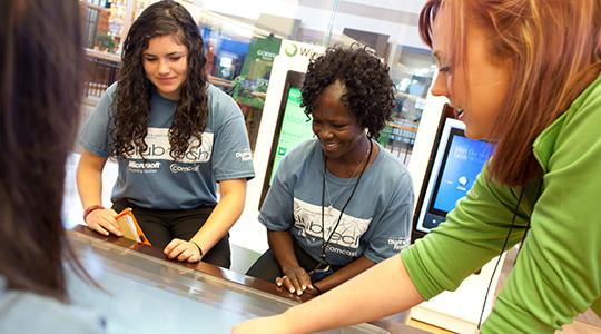 Answer Desk associates helping a customer