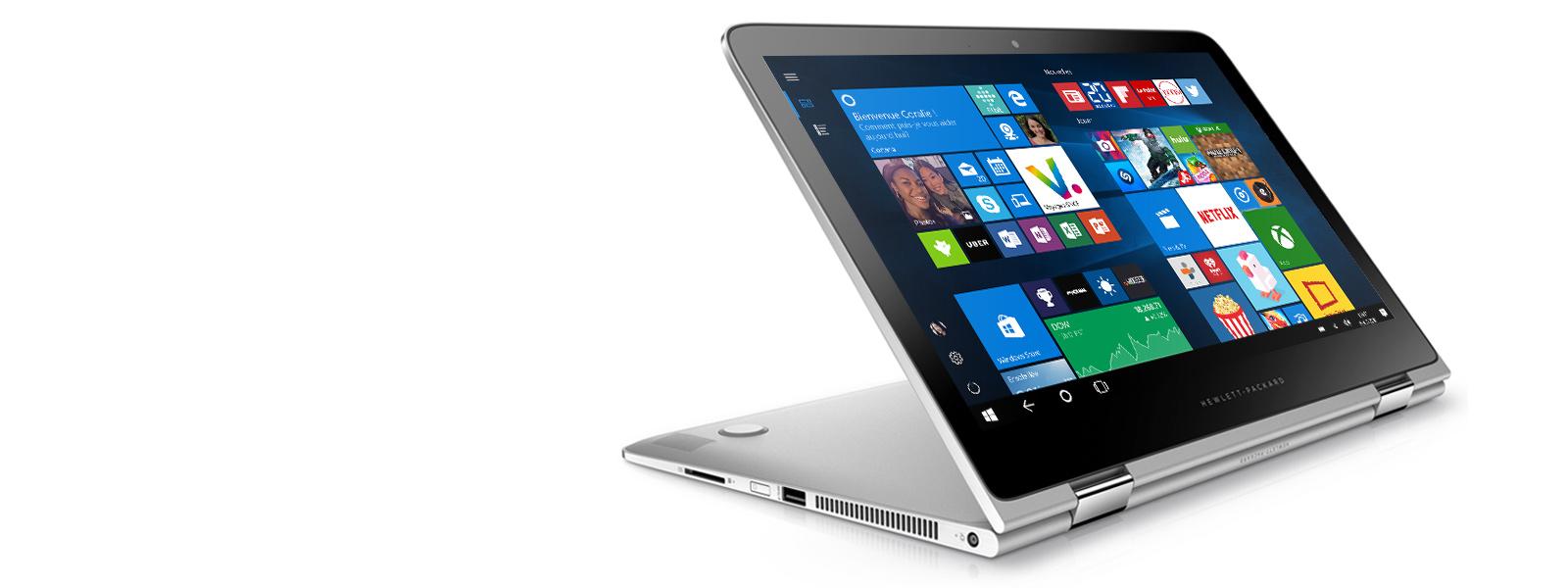 Le HP Spectre x360 est en mode tente et affiche une image de fond d'écran.