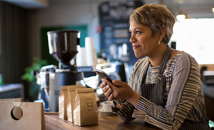 Image of a small business owner using a mobile device.