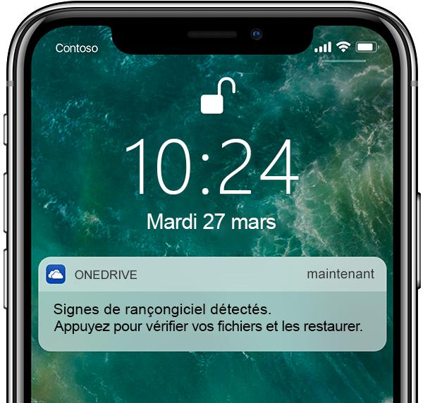 Capture d'écran d'un téléphone mobile affichant une notification de détection de rançongiciel et de récupération de fichiers.