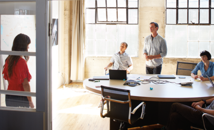 Image for: Image of four coworkers collaborating in an office.