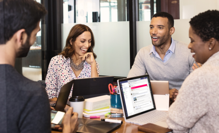 Image for: Image of four coworkers collaborating around a conference table.