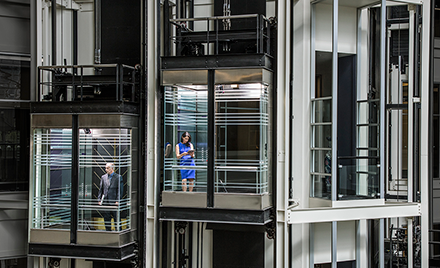 Image for: Image of two elevators passing.