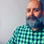Cory Delamarter poses for a portrait photo.