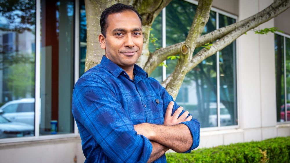 Sahil Garg poses for a picture outside of a Microsoft building.