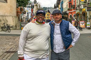 Dwight Jones (left) and Scott Kovach take in some sights on one of their many trips together. Here they stand in front of a series of buildings looking over a pedestrian walkway in Kitzbuhel, Austria.