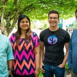 Nirag Tibdewal, Loviee Makkar, Stephen Smith, Software engineers in CSEO and Ullas Kumble, lead software engineer in CSEO, smile for a photo outside.