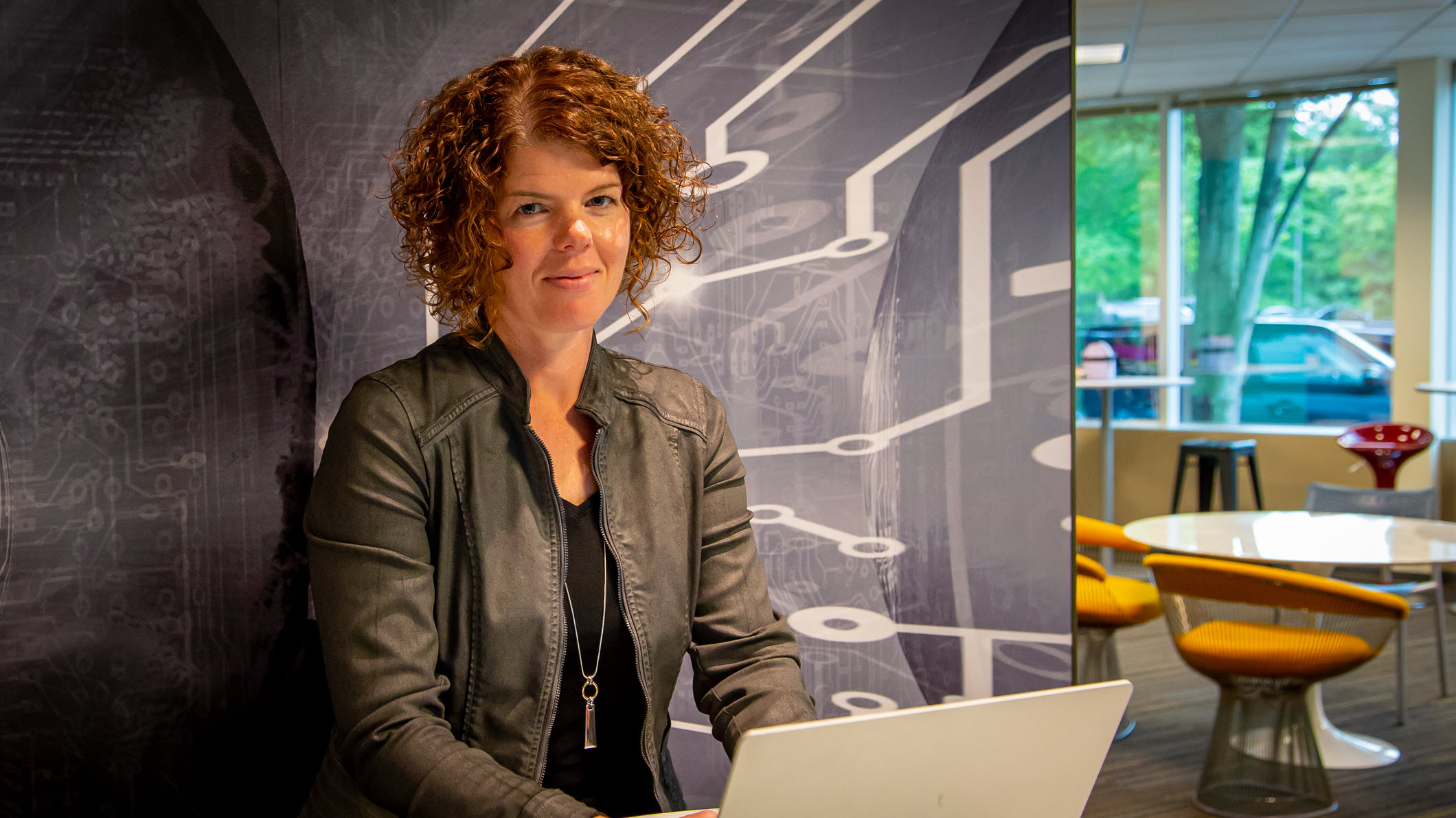 Kim Kunes works at her PC in an open space near her office on the Microsoft campus.