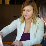 Anne Marie Suchanek shows another Microsoft employee something on her PC.