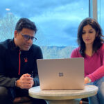 Microsoft CSEO colleagues Akshatha Pai and Iliyas Chawdhary sit together looking at a laptop.