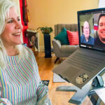 Corine Kuchling talks to Johan Bosch and Daniel Manalo from her home office while Bosch and Manalo are shown on her computer screen.