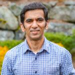 Karthik Ravindran looks at the camera and smiles.