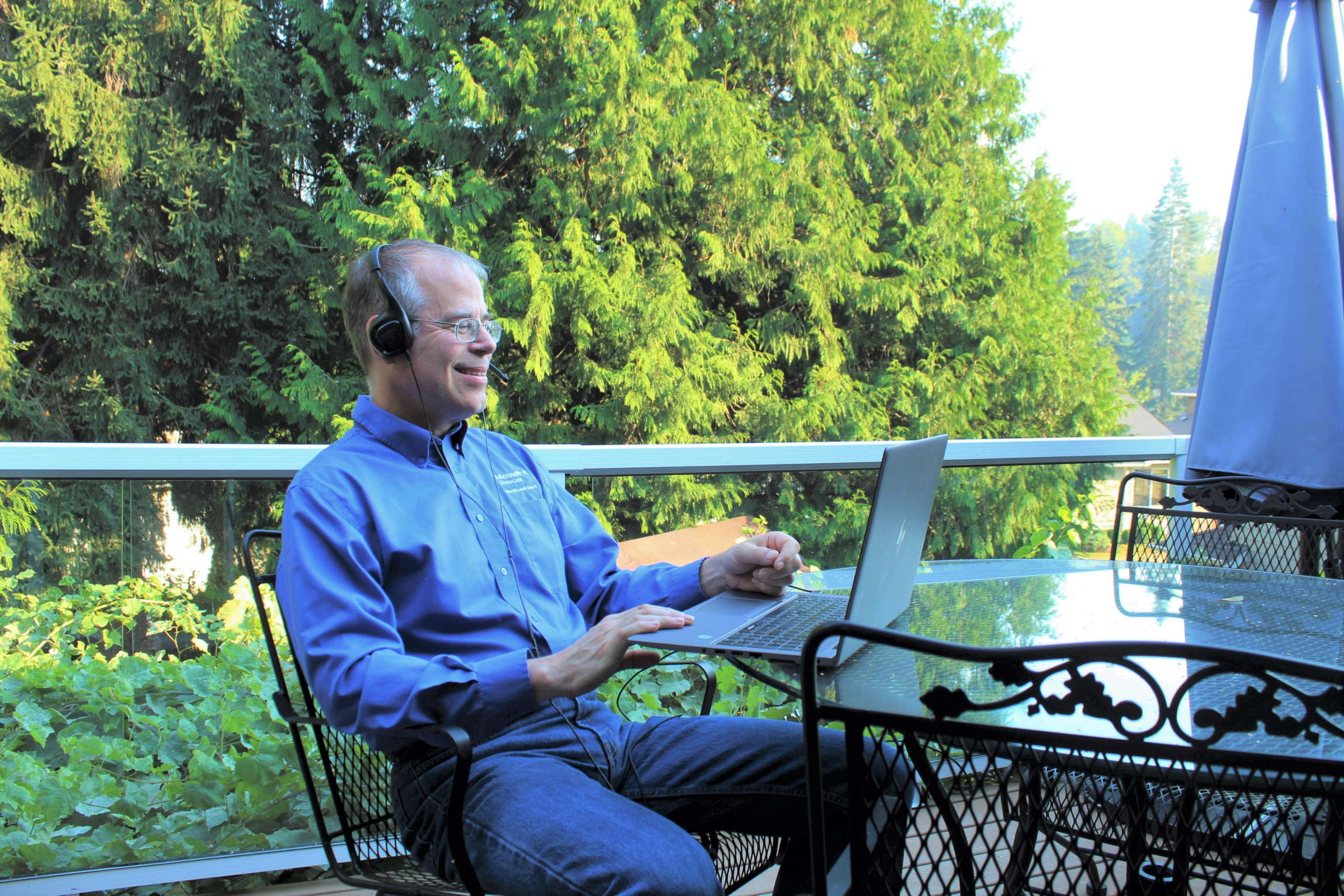 Dodd Willingham sits on his porch with his laptop, checking in with his search administration team.
