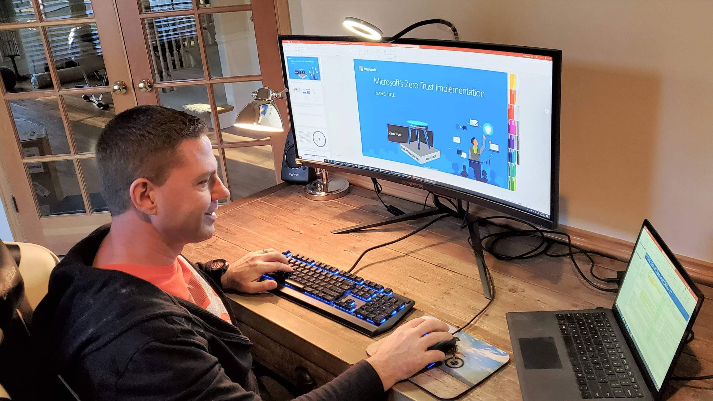 Mark Skorupa sits at his desk and looks at this laptop.