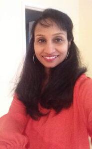 Soumya Subramanian looks at the camera and smiles.