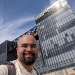 Daniel Lee smiles while taking a selfie in front of the Microsoft Herzliya campus building.