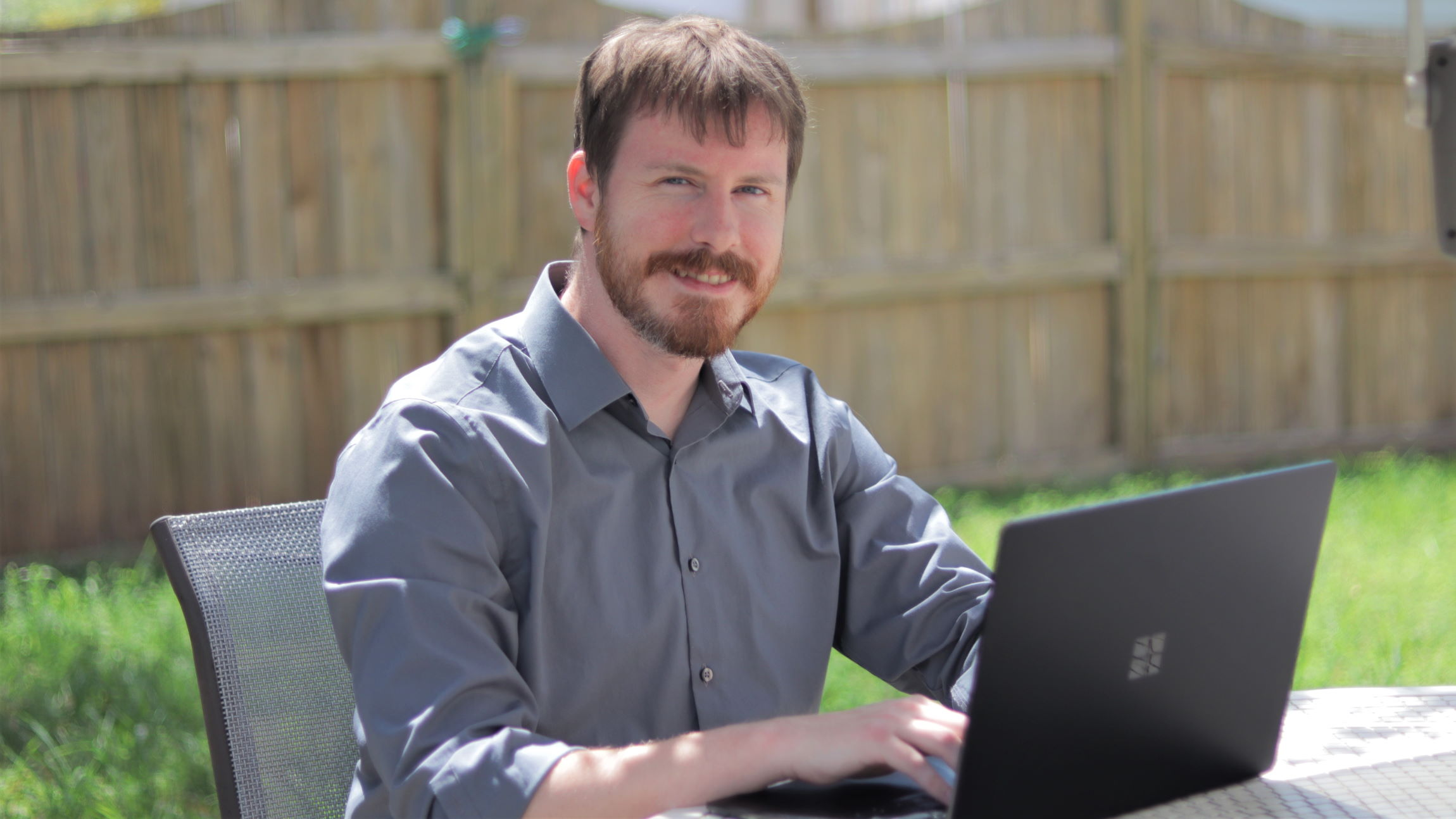 Jon Griffeth sits at his computer in a photo.