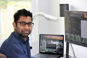 Manabendra Roy works at home on his computer.