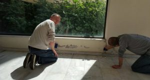 Anders Jepsen and Davide Recalcati scrape and patch the walls