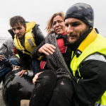 ERCI helping refugees reach shore safely.