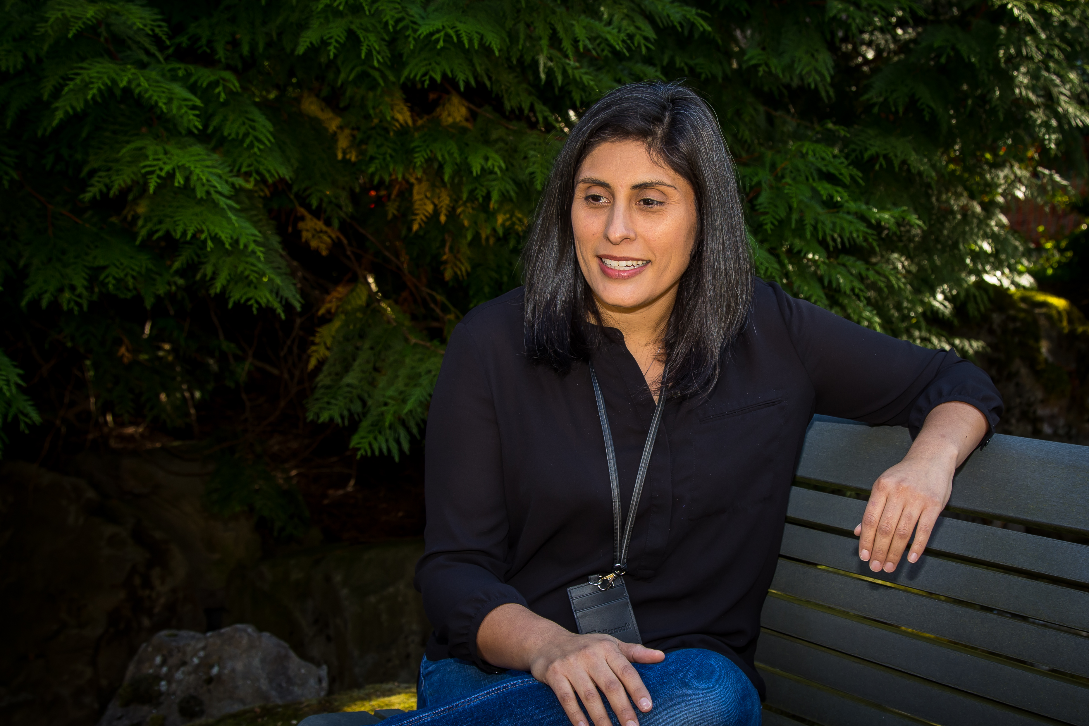 Marisela Cerda sitting on a bench outside of her office at Microsoft