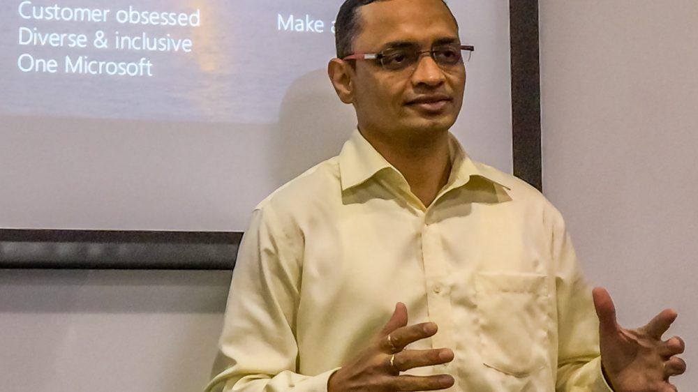 Deependra (Deep) Sengar speaks in front of a whiteboard.