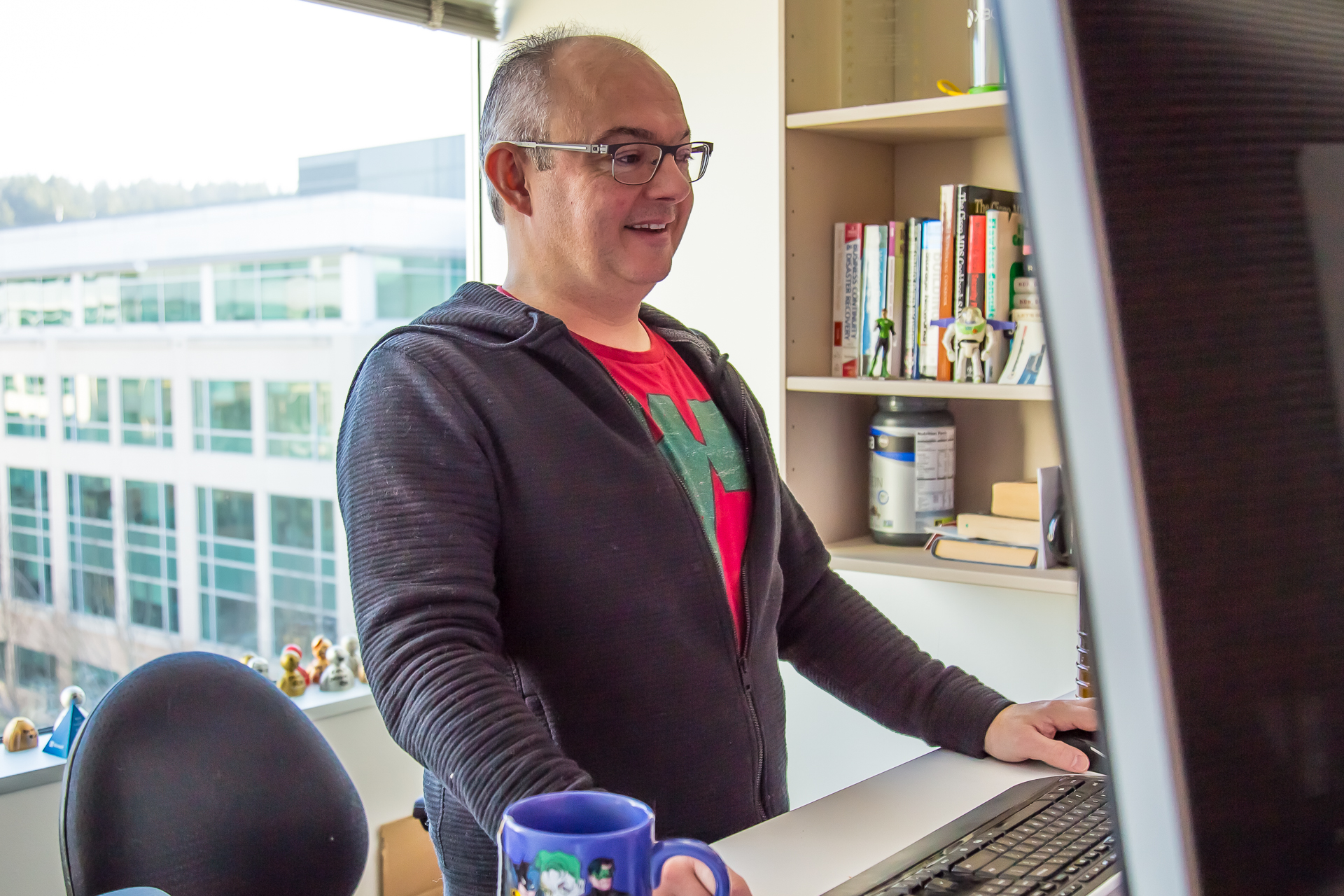 Rob Beddard works on his computer in his office.