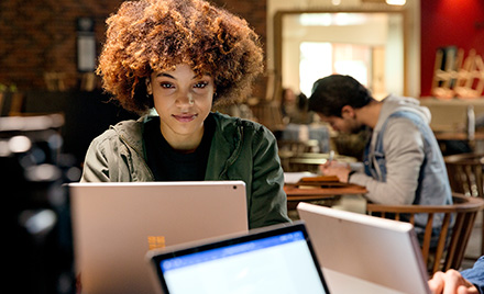 Image of an office worker working on her computer.