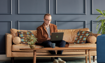 Image of a man working on a couch.