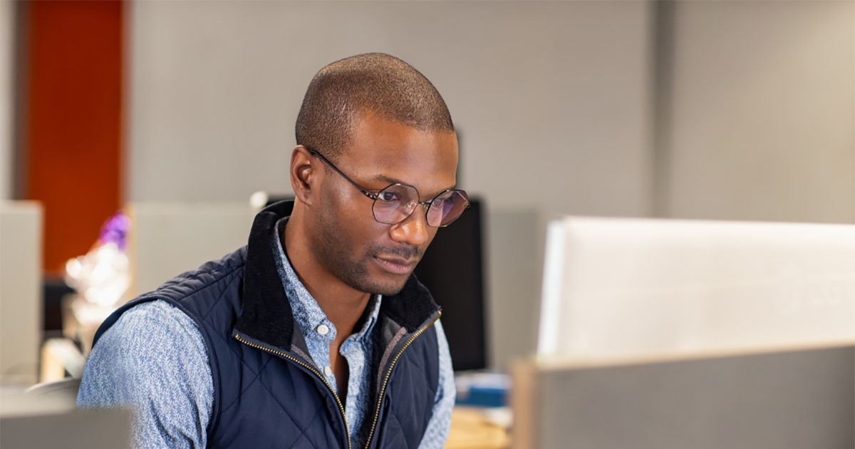 An image of a black male developer at work in an Enterprise office workspace.