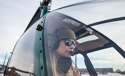 Image of a woman in a helicopter.