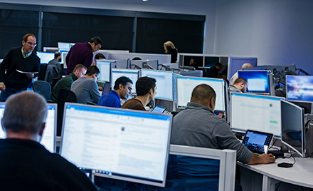 Image of security IT workers in an office setting.