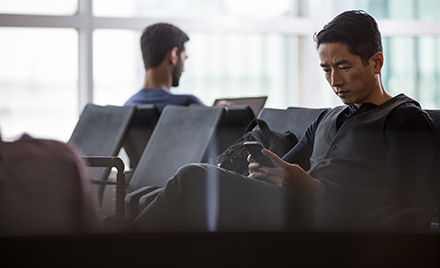 Enterprise male achieving in airport during business travel and mobility.