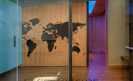 Image of an office hallway with a map of the world carved into it.