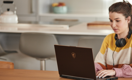 Image of a worker at her desk at home.