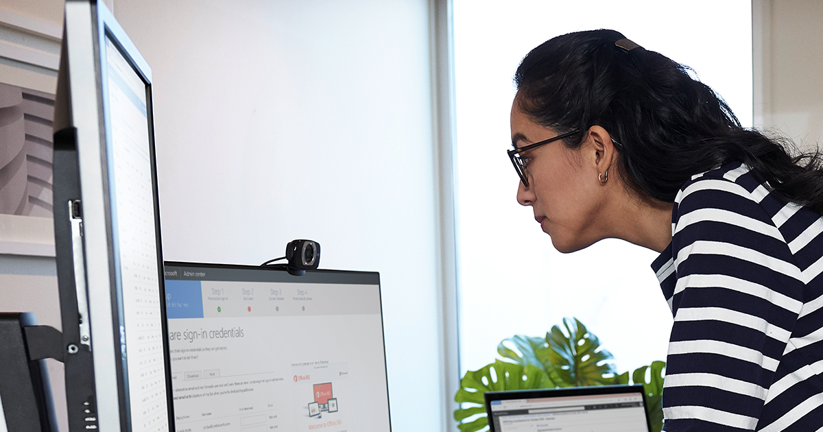 Image of a remote worker on her desktop PC.