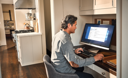 Man interacting with an Asus Viv0Book desktop