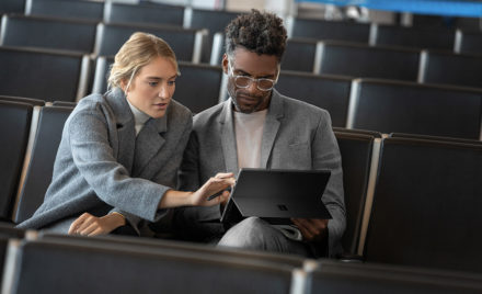 Contextual image of man and woman collaborating while working on Surface Pro6